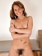 Smiling Susanna with nice hairy pussy