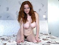 Elouisa is a sexy redhead masturbating in bed