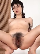 Frida strips naked on her leather chair