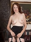 Jenny Smith puts on erotic striptease in study