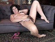 Sharlyn undresses in study and masturbates on sofa