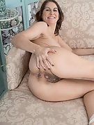 Kaysy strips and gets naked on her sofa